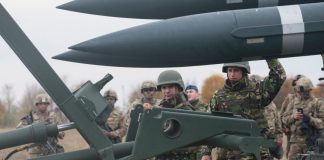 Photograph of missiles accompanied by Romanian troops