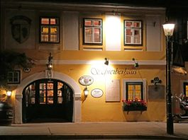 Photo of an Austrian restaurant/hotel lit by a streetlight