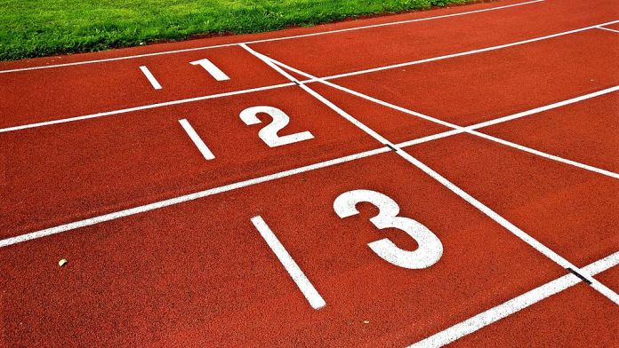 Image of numbers on the lanes of a running track.