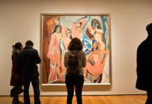 "Silhouettes of people in front of Picasso's painting ""Les Demoiselles d'Avignon"""