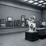 Black and white photograph of a cubist exhibition in a museum