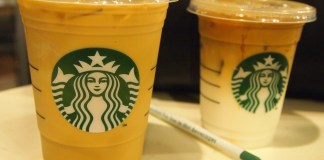 Photograph of two iced Starbucks drinks with a wrapped straw in between them
