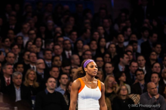 Photograph of tennis athlete Serena Williams with a crowd behind her