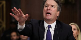 Photograph of Brett Kavanaugh with his hand raised in anger