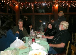 Group of people gathered around a holiday table
