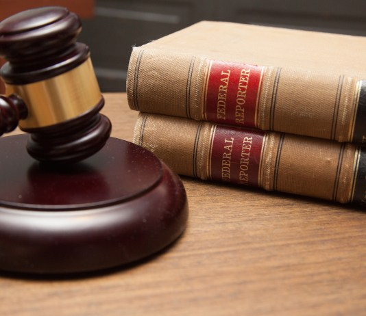 Photograph of a gavel next to two large books