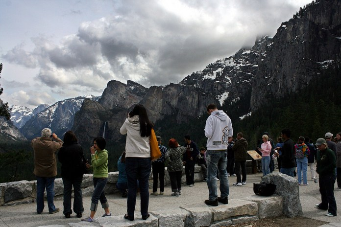 Photograph of tourists at scenic overview.