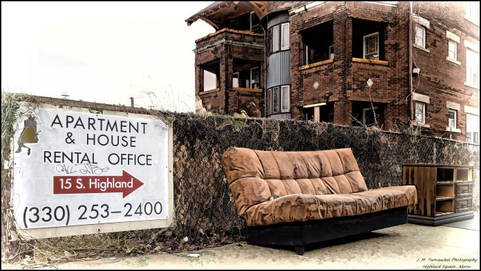 A couch sits below a rental office.