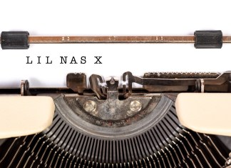 "Photograph of a type writer with the words ""Lil Nas X"" having just been typed"