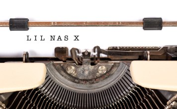 """Photograph of a type writer with the words """"Lil Nas X"""" having just been typed"""