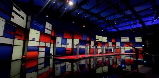 photo of empty studio with debate podiums