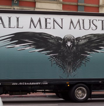 """photograph of """"all men must die"""" billboard for Game of Thrones"""