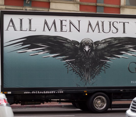 "photograph of ""all men must die"" billboard for Game of Thrones"