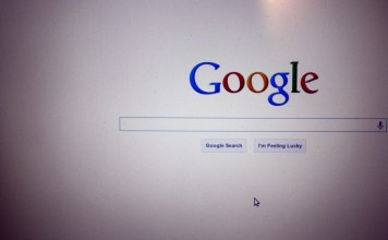 photograph of computer screen with empty Google searchbar