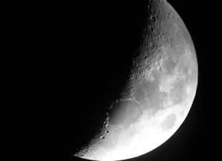 photograph of the surface of the moon (half)