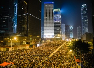 photograph of protest at night in Hong Kong