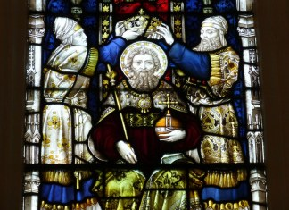 photograph of stained glass depicting crowning of religious figure