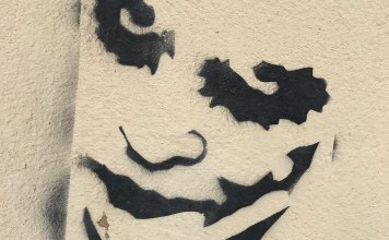 photograph of joker graffiti on wall