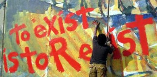 """photograph of """"to exist is to resist"""" mural"""