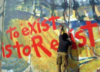 "photograph of ""to exist is to resist"" mural"
