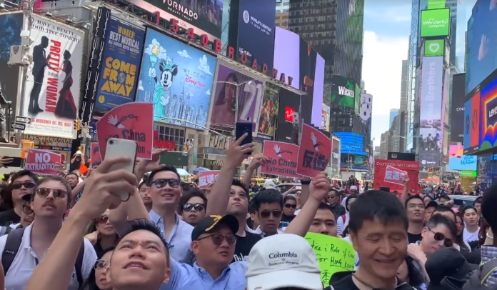 photograph of protest in NYC with many participants streaming on iphones