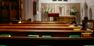 photograph of empty church pews
