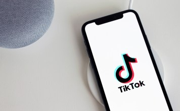 photograph of TikTok icon on ipod sitting on empty counter
