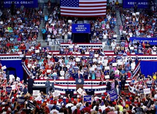 photograph of packed arena at Trump rally