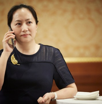 photograph of Meng Wanzhou on a moblie phone at business function
