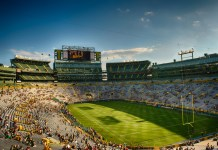 photograph of Green Bay Packers stadium lightly populated before game