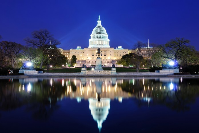 photograph of US Capitol Building with mirror image reflected in lake