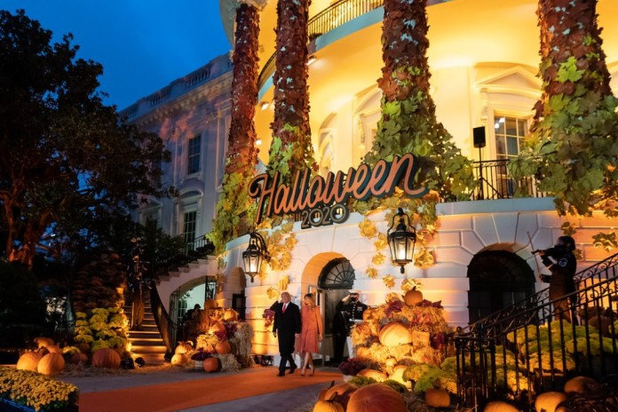 photograph of Halloween event at White House with Donald and Melania Trump