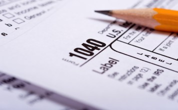 photograph of pencil lying on 1040 tax form