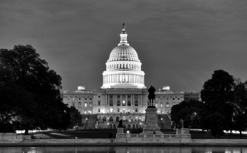 black-and-white photograph of the Capitol building at night
