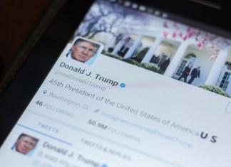 photograph of President Trump's twitter bio displayed on tablet