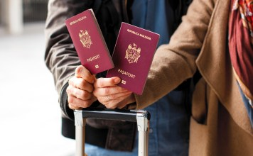 photograph of couple presenting passport