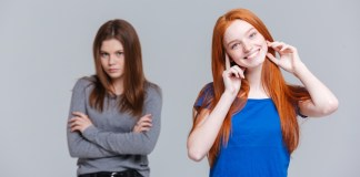 photograph of two young women of different attitudes