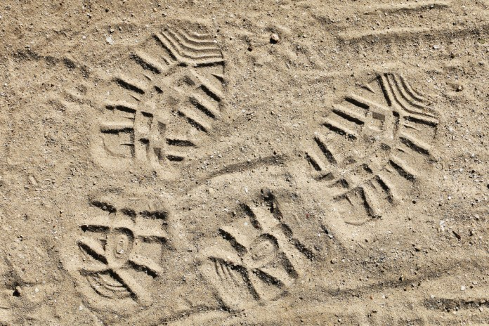 photograph of bootprints in the sand