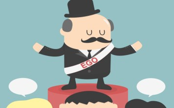 """image of man in top hat on pedestal with """"EGO"""" sash"""