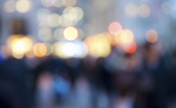 blurred image of crowd and streetlights
