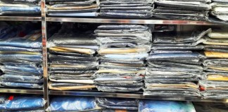 photograph of shelves of shirts in shrinkwrap