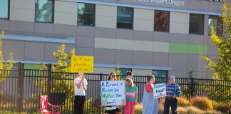 photograph of pro-life protestors in front of Planned Parenthood