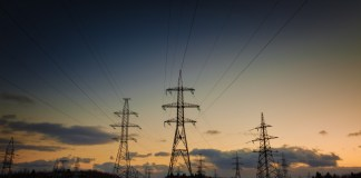 photograph of electric power pylons in winter landscape