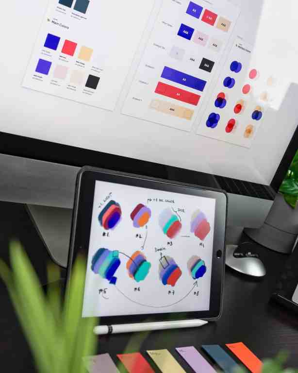 Choosing brand colors on a iPad and desktop computer.
