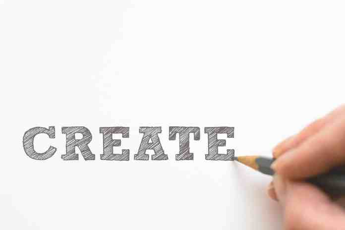 Hand writing the word create