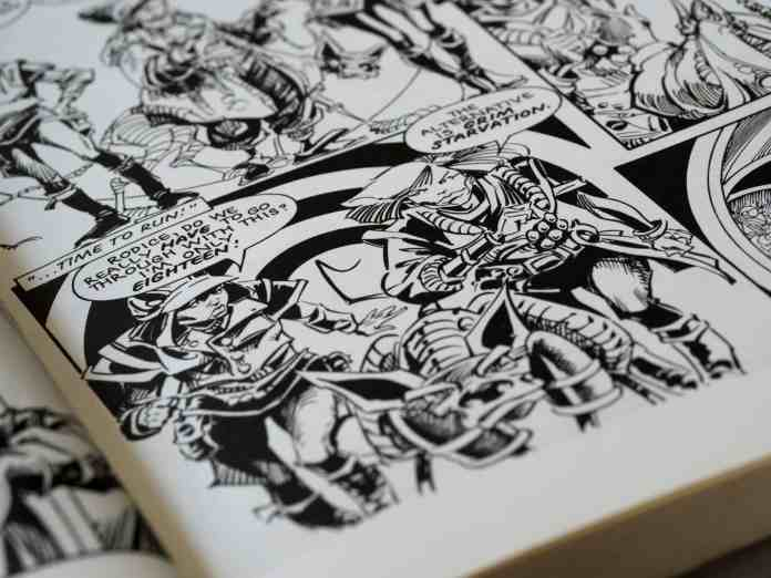 Close up of a comic book with dialogue bubbles and characters