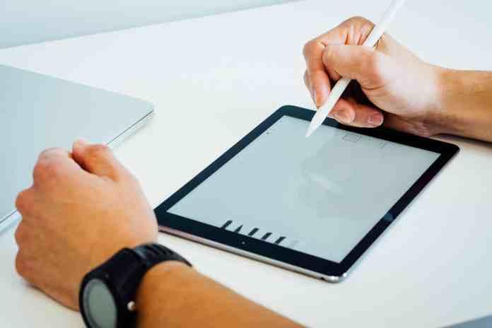 Someone designing on an iPad