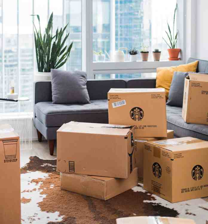 Branded shipping boxes in front of a couch