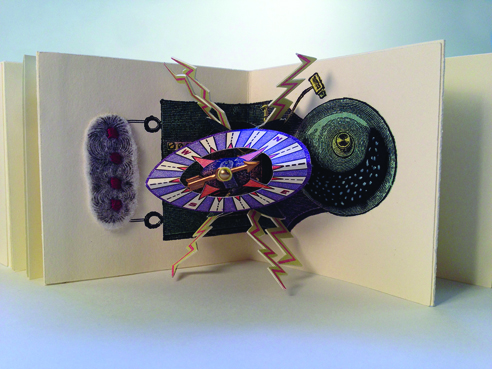 photo of Memories of Science accordion by Dorothy A. Yule, 2012; detail of electromagnet pop-up