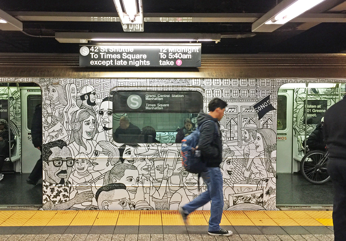 A Subway train wrapped in Mark Alan Stamaty Cartoons